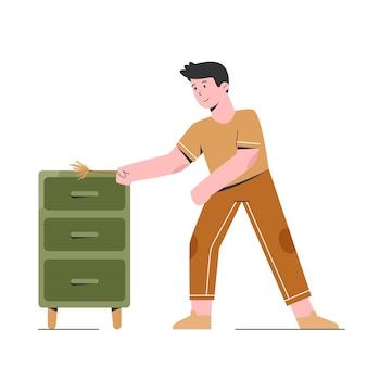 Uomo che pulisce la mensola dell'armadio