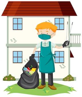 Un uomo che pulisce il cortile