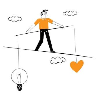 L'uomo si arrampica su un filo con cuore e cervello in equilibrio