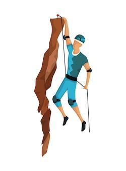 Uomo che si arrampica su una montagna rocciosa con attrezzatura professionale