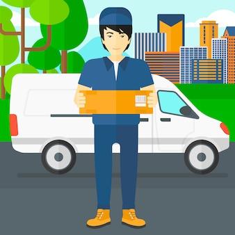 Uomo che consegna scatola