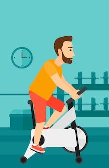 Uomo che fa esercizio in bicicletta
