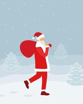 Un uomo vestito da babbo natale cammina nella neve con un sacco di regali.