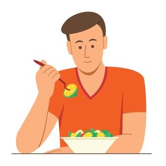 L'uomo mangia l'insalata per una buona salute