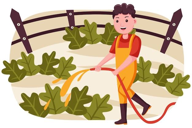 Coltivatore dell'uomo che innaffia le piante al giardino.