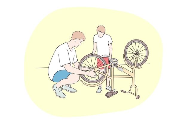 L'uomo padre meccanico papà papà aiuta il figlio ragazzino