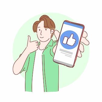 Uomo che gesturing i pollici in su e che mostra smartphone. concetto di business marketing online.