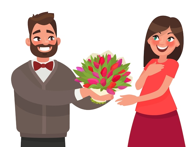 L'uomo regala a una donna un mazzo di fiori. congratulazioni per una vacanza o un compleanno.
