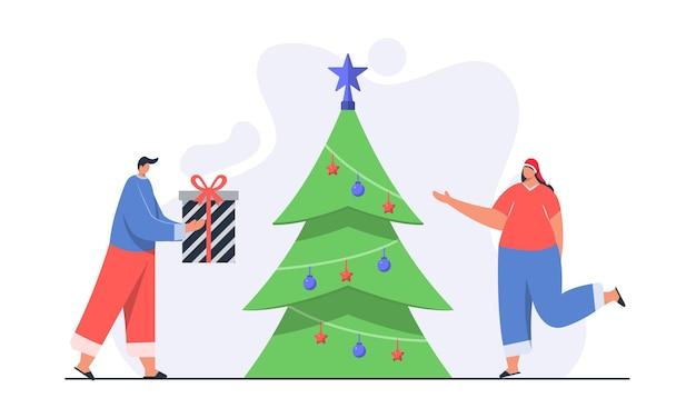 Uomo che dà l'illustrazione del concetto di scatola regalo di natale