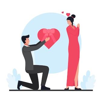 Uomo che dà una confezione regalo alla donna il giorno di san valentino.