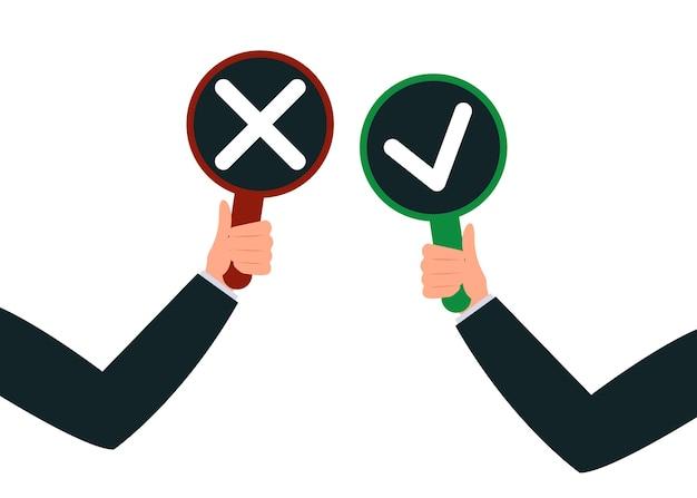 Mani dell'uomo tengono segno di spunta cartello e rosso vietato