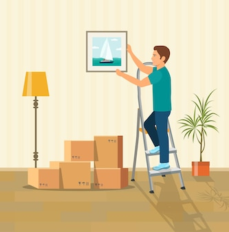 Uomo che appende un quadro al muro. scatole per trasloco nella nuova casa. illustrazione di stile piatto vettoriale