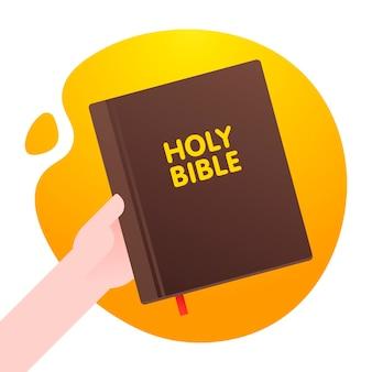 L'uomo tiene la sacra bibbia in mano, life foundation bible sullo sfondo arancione forma astratta. .