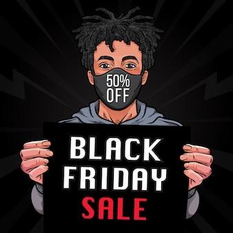 Uomo che tiene promozione sconto vendita venerdì nero su carta
