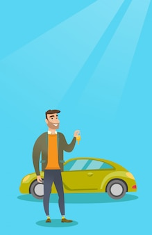 Uomo che tiene le chiavi della sua nuova auto.
