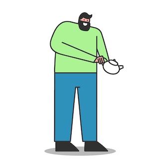 Uomo che tiene la teiera e versando il tè isolato