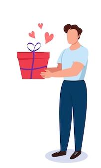 Un uomo tiene una confezione regalo nelle sue mani con i cuori
