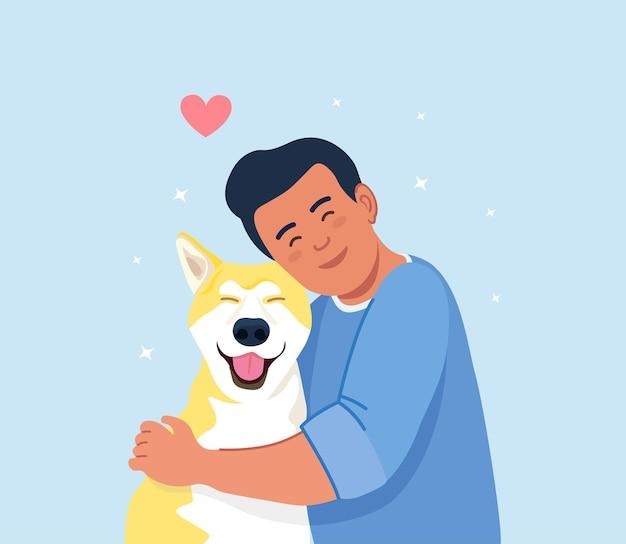 Cane abbraccio uomo. giovane ragazzo che abbraccia cucciolo con amore. amicizia di ragazzo e animale domestico. prendersi cura di un amico a quattro zampe