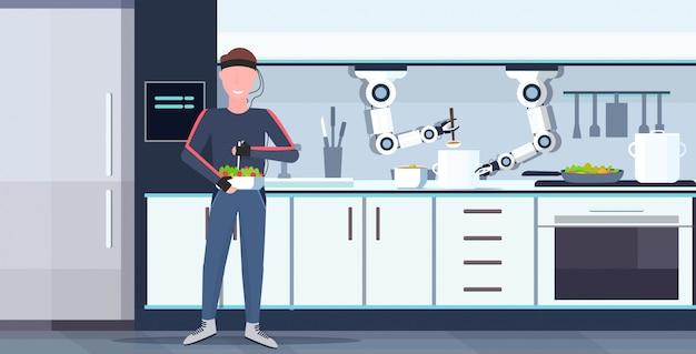 Uomo umanoide con fili elettrodi indicatori controllo robot pratico pratico cuoco preparare cibo robot assistente innovazione intelligenza artificiale concetto moderno cucina interno orizzontale