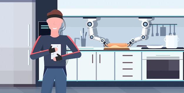 Uomo umanoide con fili elettrodi indicatori tramite app mobile controllo intelligente pratico chef robot robot assistente innovazione intelligenza artificiale concetto moderno cucina interno orizzontale
