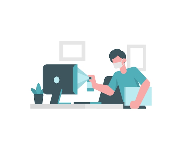 Un uomo sta pulendo il computer prima di lavorare a casa