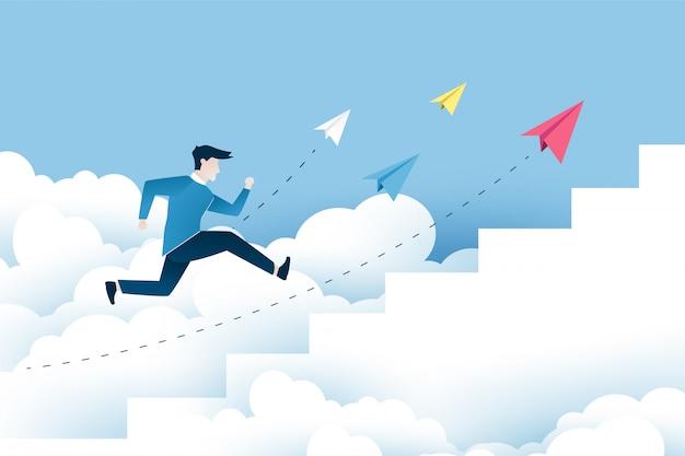 Un uomo sta saltando sulle scale, passi verso il successo.