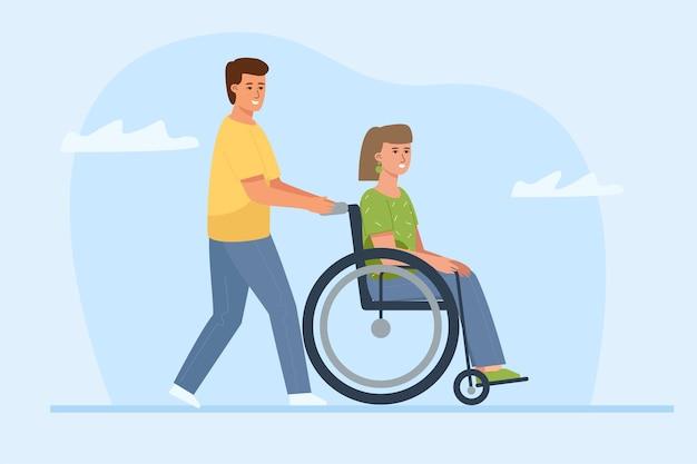 Un uomo sta spingendo una sedia a rotelle con una bella giovane donna. una data di persona disabile.