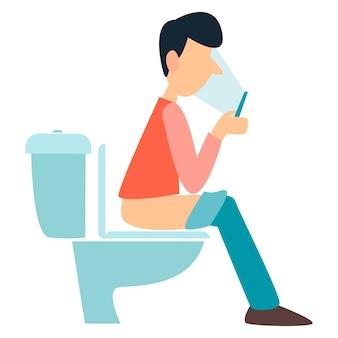 Un uomo è seduto sul water problemi con lo stomaco emorroidi diarrea