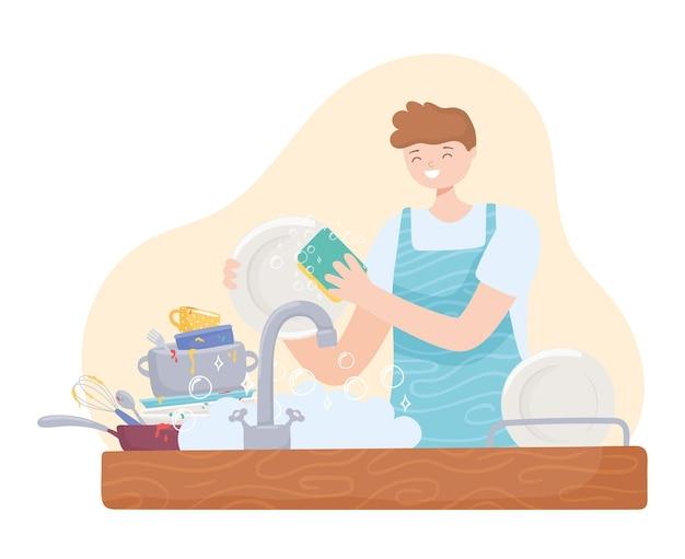 Uomo in cucina che lava