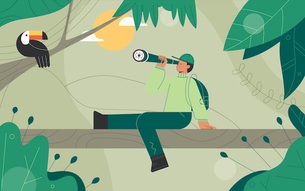 L'uomo guarda l'uccello tucano attraverso il binocolo