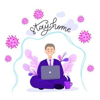 Uomo nella posa del loto che lavora al suo computer portatile