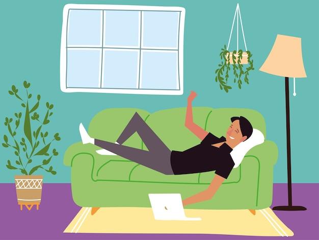 Uomo disteso su un divano a guardare su un computer, attività indoor