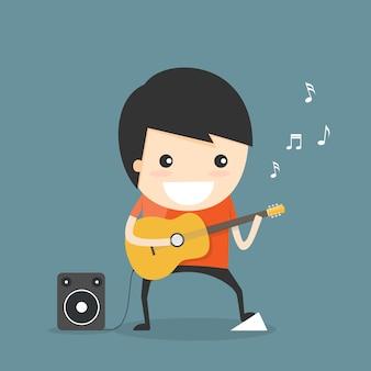 L'uomo suona la chitarra.