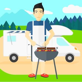 Uomo che prepara barbecue.