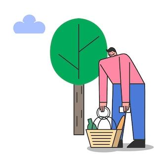 Uomo che prepara picnic nel parco per appuntamento romantico con la donna. maschio del fumetto con cestino da picnic di cibo gustoso all'aperto