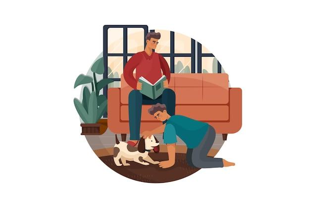 Uomo che legge il libro mentre suo figlio gioca con il cane