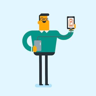 Uomo che ricarica smartphone dalla batteria portatile.
