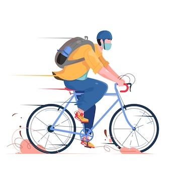 L'uomo va in bicicletta con il timone e la maschera
