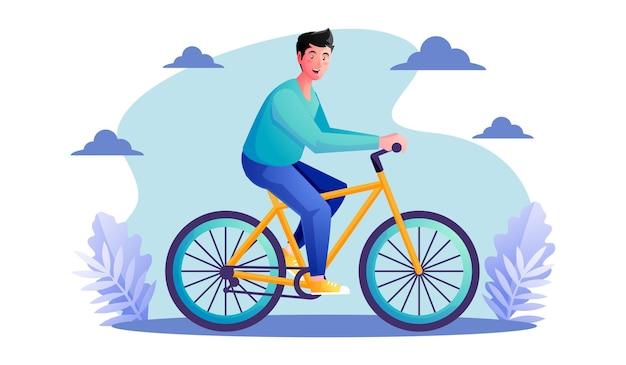 Uomo che guida le biciclette nel parco