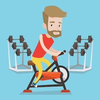 Uomo che guida bicicletta stazionaria.