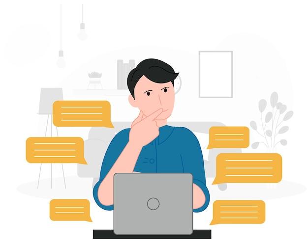 Uomo seduto con laptop
