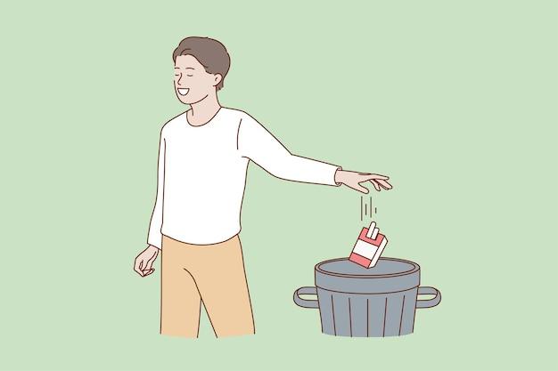 L'uomo smette di fumare, butta via il pacchetto di sigarette