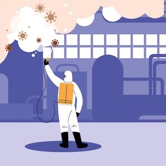 L'uomo in tuta disinfettare l'industria
