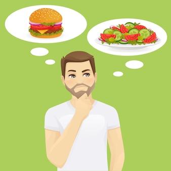 Uomo che pensa di scegliere tra insalata e hamburger, cibo sano e spazzatura. illustrazione vettoriale di dieta