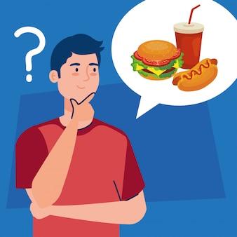 Uomo che pensa nel cibo spazzatura