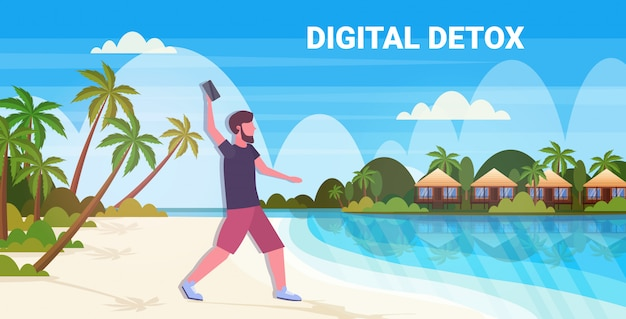 Uomo gettando via il concetto di disintossicazione digitale smartphone ragazzo rilassante sulla spiaggia tropicale abbandonando gadget