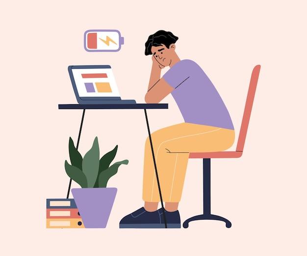 Uomo stanco di lavorare sodo, esaurimento a causa del lavoro, ragazzo in ufficio seduto al tavolo con il laptop e procrastinare