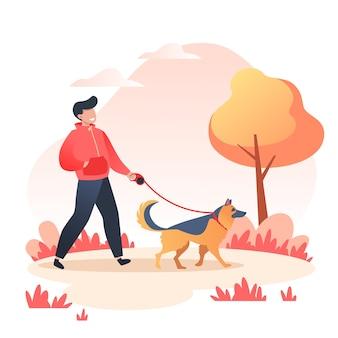 Uomo che cammina il suo cane felice nella sosta di autunno, concetto di cura degli animali domestici, pastore tedesco di razza di cane