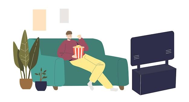 Uomo che guarda un film commedia a casa seduto sul pullman