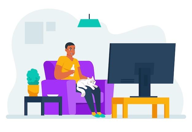 L'uomo guarda la tv. ragazzo del fumetto seduto sul divano di casa e guardando film o documentari sul servizio di streaming. l'uomo di stile di vita dell'illustrazione vettoriale guarda il programma televisivo preferito e si rilassa